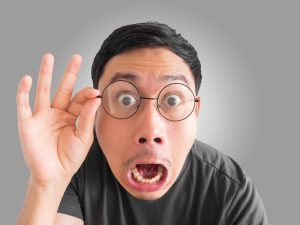 Funny shocked and surprised face of man.